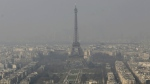 The Eiffel Tower is photographed through the smog in Paris on March 14, 2014. (AP / Jacques Brinon)