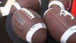 Autographed footballs - Stampeders kickoff