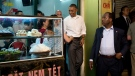 President Barack Obama greets people at the door as he walks from the Bún ch Huong Liên restaurant after having dinner with American Chef Anthony Bourdain, Monday, May 23, 2016, in Hanoi, Vietnam. (AP / Carolyn Kaster)