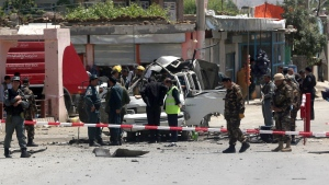 Afghanistan security forces inspect the site of a suicide attack in west Kabul, Afghanistan on Wednesday, May 25, 2016. (AP / Massoud Hossaini)