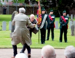 Canadian Ambassador to Ireland Kevin Vickers, right, wrestles with a protester during a State ceremony to remember the British soldiers who died during the Easter Rising at Grangegorman Military Cemetery, Dublin Thursday May 26, 2016. (SWNS)