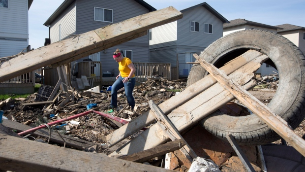 A resident of the Timberlea neighbourhood looks over the damage of the area in Fort McMurray, Alta., on Thursday, June 2, 2016. Members of the community are slowly being allowed back into their homes. THE CANADIAN PRESS/Jason Franson