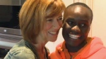 Maureen Kehler shares a laugh with a member of the Mully Children's Family visiting from Kenya in her southwest home