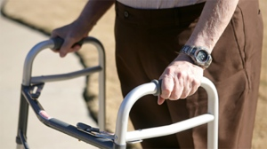 A senior citizen uses a walker in this file photo.