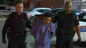 Jin Qing Huang, 42, is charged with first-degree murder in the stabbing death of Tiejun Huang.