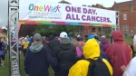 Rain jackets, hats and umbrellas at the start of Saurday's OneWalk to Conquer Cancer