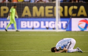 Argentina's Lionel Messi reacts after losing 4-2 to Chile in penalty kicks in the Copa America Centenario championship soccer match, Sunday, June 26, 2016, in East Rutherford, N.J. (AP Photo/Julio Cortez)