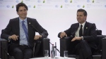 Canadian Prime Minister Justin Trudeau laughs as he speaks with Mexican President Enrique Pena Nieto during a session on carbon pricing at the United Nations climate change summit in Le Bourget, France on Monday, Nov. 30, 2015. (Adrian Wyld / THE CANADIAN PRESS)