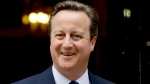 Britain's Prime Minister David Cameron leaves 10 Downing Street in London on June 27, 2016. (Matt Dunham / AP)