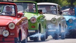 Trabi Live Parade at the 18th International Trabant Meeting in Zwickau, eastern Germany, on June 14, 2015. (Jens Meyer / AP)