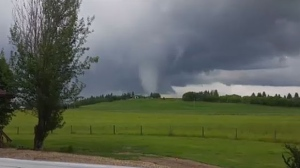 Environment Canada investigators have been sent to Ponoka to determine if a funnel cloud touched down in the community.