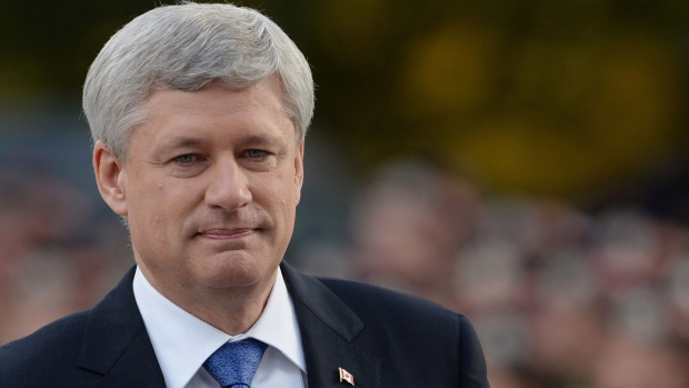 Prime Minister Stephen Harper arrives at a ceremony marking the one year anniversary of the attack on Parliament hill Thursday Oct. 22, 2015 at the National War Memorial in Ottawa. (Sean Kilpatrick / THE CANADIAN PRESS)