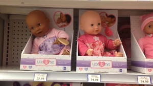 Price difference between black and white dolls raises eyebrows.