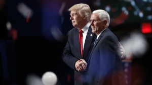 Republican Presidential Candidate Donald Trump and Republican Vice Presidential Nominee Gov. Mike Pence of Indiana shake hands during celebrations following Trump's acceptance speech on the final day of the Republican National Convention in Cleveland on Thursday, July 21, 2016. (AP / Paul Sancya)