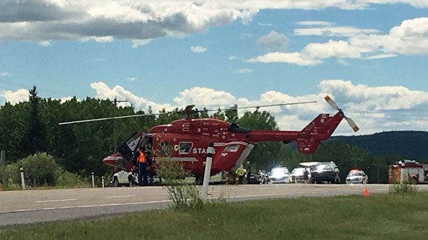 STARS helicopter on Highway 22 near Millarville following a crash involving a motorcycle and an SUV