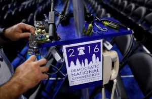 A worker wires a phone on the convention floor as setup continue before the 2016 Democratic Convention in Philadelphia, Saturday, July 23, 2016. (AP / Carolyn Kaster)