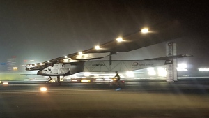 The Solar Impulse 2 plane lands in an airport in Abu Dhabi, United Arab Emirates marking the historic end of the first attempt to fly around the world without a drop of fuel, powered solely by the sun's energy on Tuesday, July 26, 2016. (AP / Aya Batrawy)