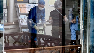 Police investigators check at Tsukui Yamayuri-en, a facility for the handicapped where a number of people were killed and dozens injured in a knife attack in Sagamihara, outside Tokyo Tuesday, July 26, 2016. (AP / Eugene Hoshiko)