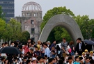 In this May 26, 2016 file photo, people visit the Hiroshima Peace Memorial Park in Hiroshima, Hiroshima Prefecture, southern Japan. (AP Photo/Shuji Kajiyama, File)