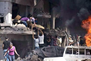 In this photo released by the Syrian official news agency SANA, Syrians carry the body of a victim from a building damaged in twin bombings struck Kurdish town of Qamishli, Syria, Wednesday, July 27, 2016. (SANA via AP)