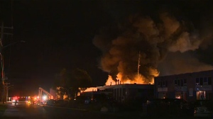 Smoke billowed high into the air above an auto recycling plant in northeast Calgary that caught fire early Thursday.