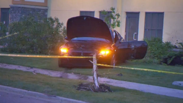 Police tape surrounds a damaged BMW following a July 26 crash in Quarry Park that sent two pedestrians to hospital