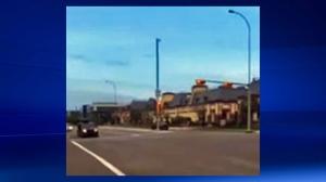 Video still of July 26 crash in Quarry Park where a BMW struck two pedestrians
