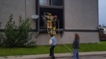 Firefighters remove a man from a Bowness apartment