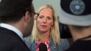 Environment Minister Catherine McKenna speaks to the media at the Liberal cabinet retreat in Sudbury, Ont., on Sunday, August 21, 2016. THE CANADIAN PRESS/Nathan Denette