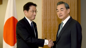 Chinese Foreign Minister Wang Yi, right, is welcomed by his Japanese counterpart Fumio Kishida prior to their bilateral meeting in Tokyo Wednesday, Aug. 24, 2016. (Toru Yamanaka/Pool Photo via AP)