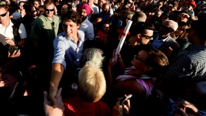 Prime Minister Justin Trudeau greets attendees as he makes his way through the crowd at a barbecue at the Liberal cabinet retreat in Sudbury, Ont., on Monday, August 22, 2016. THE CANADIAN PRESS/Nathan Denette