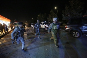 Afghan security forces rush to respond to a complex Taliban attack on the campus of the American University in the Afghan capital Kabul on Wednesday, Aug. 24, 2016. (AP Photo/Rahmat Gul)