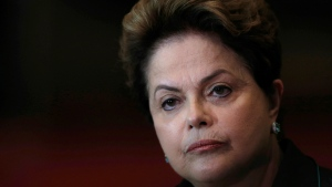 In this Oct. 6, 2014 file photo, Brazil's President Dilma Rousseff listens to a question during a re-election campaign news conference at the Alvorada Palace in Brasilia, Brazil.