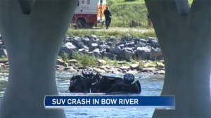 SUV rolls into Bow River