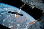 In this Friday, April 17, 2015 file photo, the Canadarm 2 reaches out to capture the SpaceX Dragon cargo spacecraft for docking to the International Space Station. (AP Photo/NASA)