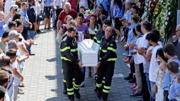 The coffin of 9-year-old Giulia Rinaldo, is carried outside the gymnasium at the end of the state funeral service in Ascoli Piceno, Italy, Saturday, Aug. 27, 2016. (AP /Gregorio Borgia)