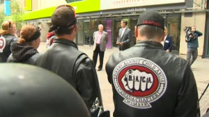 Members of Bikers Against Child Abuse gathered outside the conference.