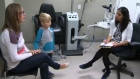Corrine Grant and her son Ashton talk with Dr. Farah Lakhani about the results of Ashton's eye exam.