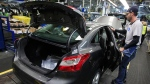 A Ford Focus on the assembly line at the Ford Michigan Assembly Plant in Wayne, Mich., on Nov. 8, 2012. (Carlos Osorio / AP)