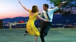 This image released by Lionsgate shows Ryan Gosling, right, and Emma Stone in a scene from, 'La La Land.' Gosling has received his second career Oscar nomination. (Dale Robinette/Lionsgate via AP)