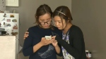 A mother and daughter wait to hear if they will be deported on Monday.