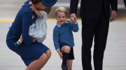 Prince George, centre, holds his father The Duke of Cambridge's hand as he smiles while listening to his mother The Duchess of Cambridge, left, holding his sister Princess Charlotte, as the family arrives in Victoria, B.C., on Saturday, September 24, 2016. THE CANADIAN PRESS/Darryl Dyck