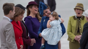 The Duchess of Cambridge, centre, holds her daughter Princess Charlotte as she speaks with British Columbia Premier Christy Clark, second left, while Prime Minister Justin Trudeau's wife Sophie Gregoire Trudeau, back, and Governor General David Johnston's wife Sharon share a laugh, upon the family's arrival in Victoria, B.C., on Saturday, September 24, 2016. (THE CANADIAN PRESS / Darryl Dyck)