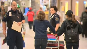 Canada Border Services officers escorted Ariunaa Demberel and her daughter Enky Ankhbayar to their flight at Calgary Internation Airport on Monday, September 26, 2016.