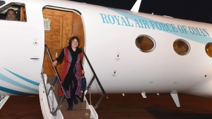 This photo made available by Oman News Agency, shows retired Iranian-Canadian professor Homa Hoodfar arriving in Muscat airport, Oman, after being released by Iranian authorities, Monday, Sept. 26, 2016. (Oman News Agency)