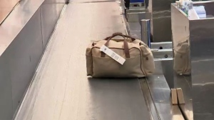 A checked piece of luggage at the Calgary International Airport