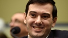 In this Feb. 4, 2016 file photo, pharmaceutical chief Martin Shkreli smiles on Capitol Hill in Washington during the House Committee on Oversight and Reform Committee hearing on his former company's decision to raise the price of a lifesaving medicine. (AP Photo/Susan Walsh, File)