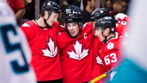 Team Canada captain Sidney Crosby (87) celebrates with teammates Jay Bouwmeester (4) and Brad Marchand (63) after a goal by teammate Patrice Bergeron (37) at the World Cup of Hockey finals in Toronto on Sept. 27, 2016. (Nathan Denette / THE CANADIAN PRESS)