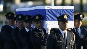 Members of the Knesset guard carry the coffin of former Israeli President Shimon Peres at the Knesset, Israel's Parliament, in Jerusalem on Thursday, Sept. 29, 2016. (AP / Ariel Schalit)