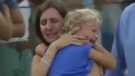 A woman embraces her daughter after the two were separated at a tennis match in Majorca, Spain.